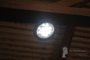 One of the solar LED lights in action in a local school.